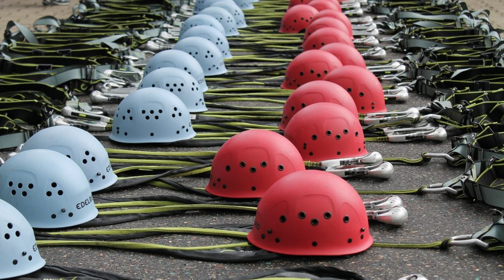 Climbing helmets red and blue
